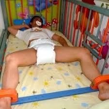 baby bondage in crib